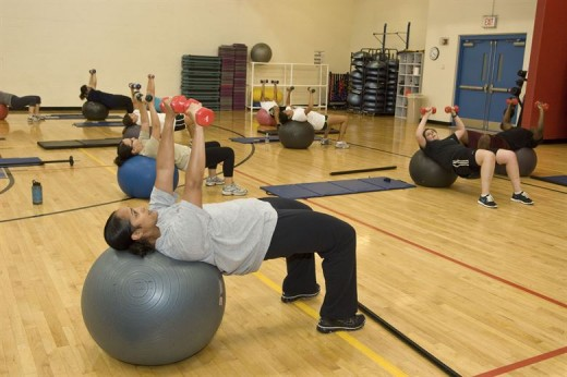 Dumbbell chest press on stability ball.