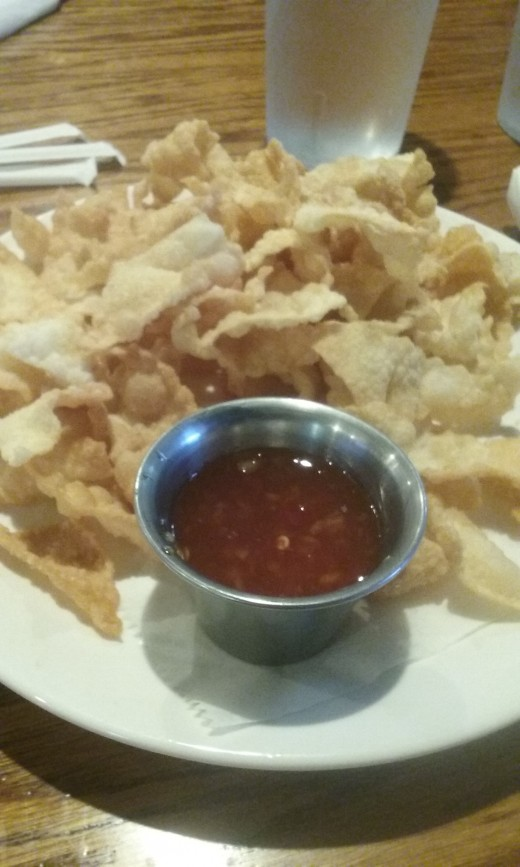 Fried wonton skins with sweet red chili sauce