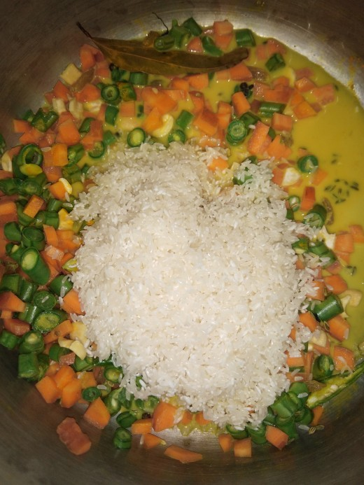 Now add washed rice, and mix properly.