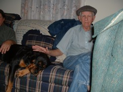My Rottweiler loves her Grandpa! (Cos he lets her on the sofa:::gasp:::)