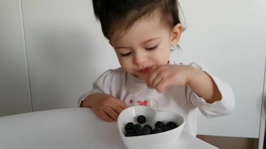 Kid Eating Blueberries