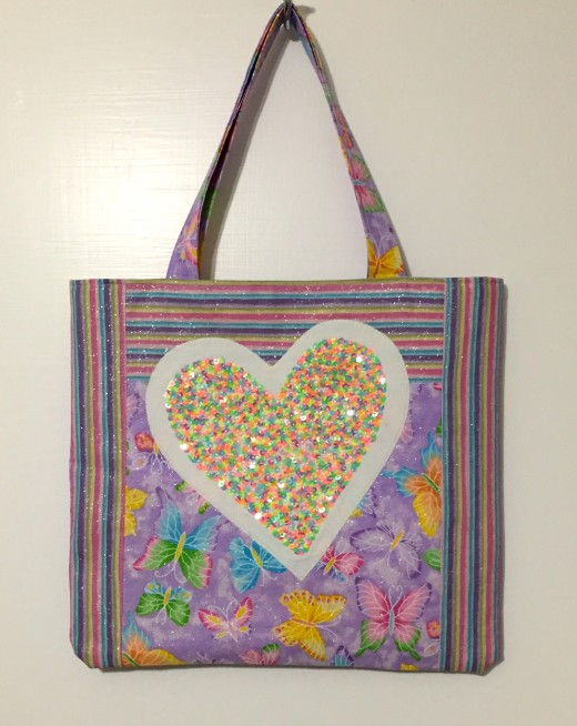 Glitter heart delighted the heart of a little granddaughter! Simple tote is lined with a pink stripe fabric.