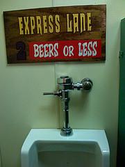 Express lane urinal sign.