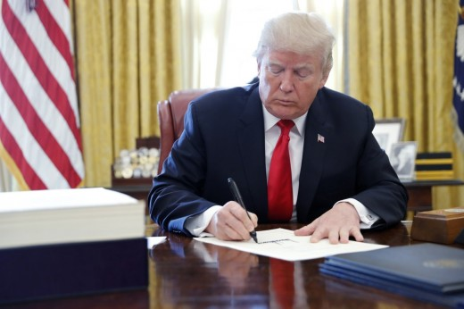 The president signing the Tax Cuts and Jobs Act into law in December 2017.