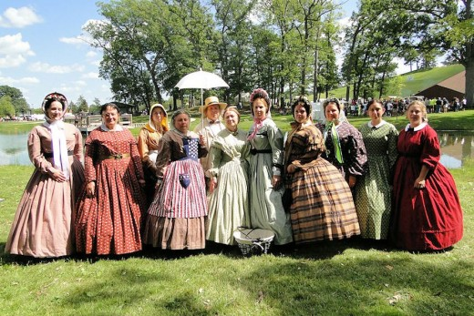 Ladies on display in authentic period costumes at August muster