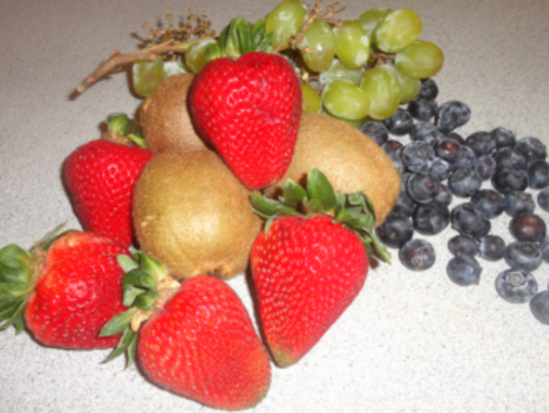 Sweet green kiwi with bright red strawberries and dark blueberries make a visually appealing combination of color.