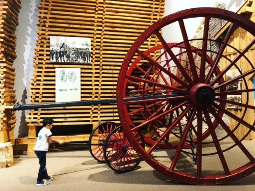 Giant wagon wheels once used to extract logs from Michigan's forests