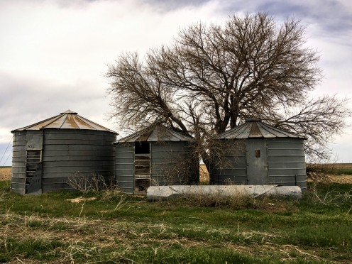 I am at once pierced with happiness and grief whenever I see old grain bins.