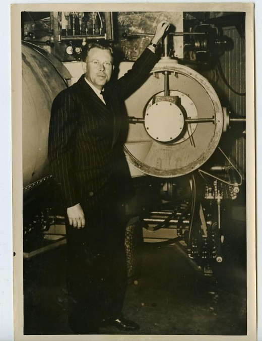 Nobel laureate Ernest Lawrence, inventor of the Cyclotron, with an early model of the machine