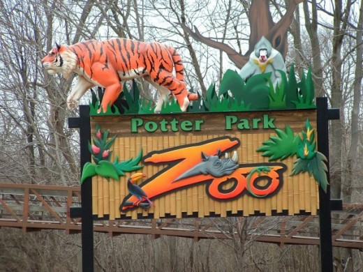 Entrance to Potter Park Zoo--a great adventure awaits.  Portion of River Trail is visible in background
