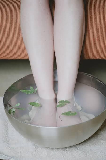Soaking feet in the hot water