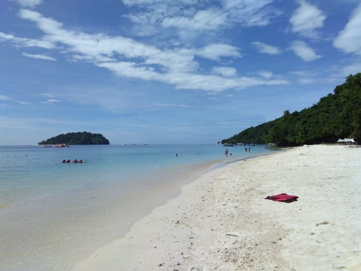 clear blue skies and waters along fine white sands of the island...bliss!