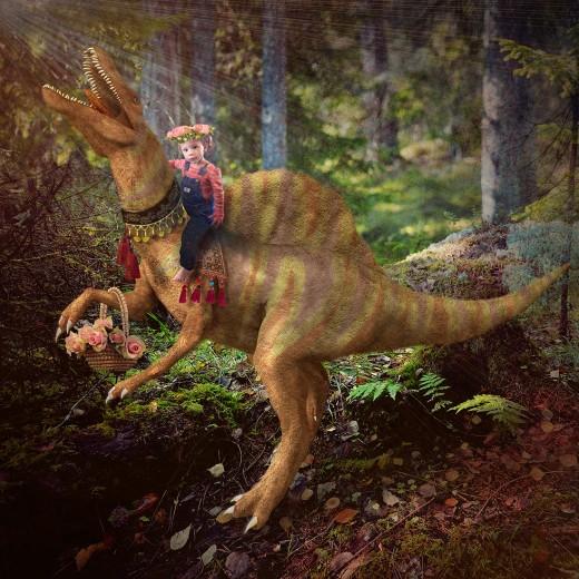 My Granddaughter riding a dinosaur.
