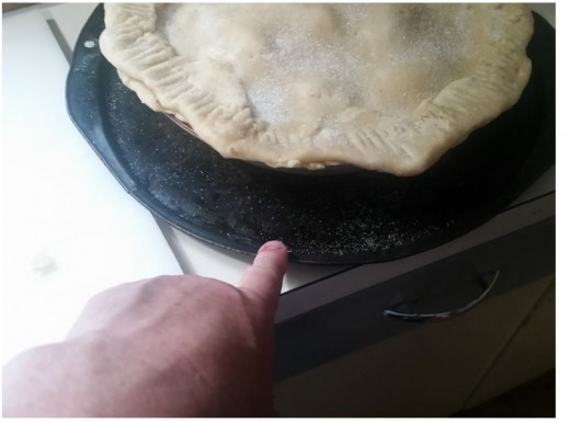 place pie on pizza pan to catch drippings