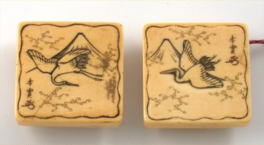 These Chinese vintage cufflinks are handcarved entirely from ivory, and they date from circa 1890.