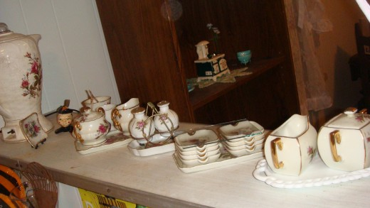 A miniture tea set with matching finger bowl, ash trays, creamer & sugar bowls!