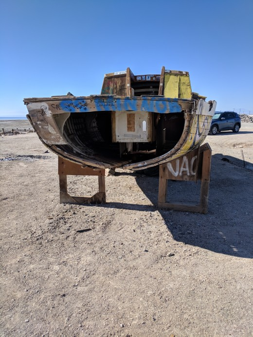 Rear view of boat abandoned on Bombay Beach as the shrinking Salton Sea leaves it ever further from the sea.