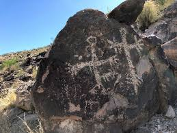 After an amazing journey through a stunning Joshua Tree Forest we arrive on the edge of an ancient dry lake where we view very unusual Indian Petroglyphs which are thousands of years old