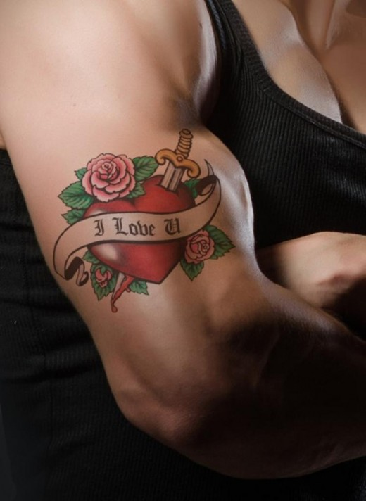"""A tattoo with the words """"I Love"""" on a man's upper arm."""