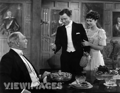 John Clements and June Duprez confronting C. Aubrey Smith