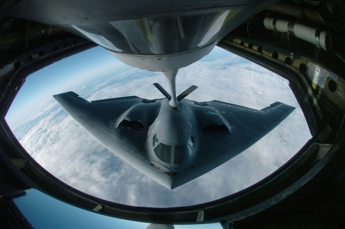 A B-2 during aerial refueling which extends its bombing  range past 6,000 nautical miles (6,900 mi; 11,000 km) for intercontinental sorties.