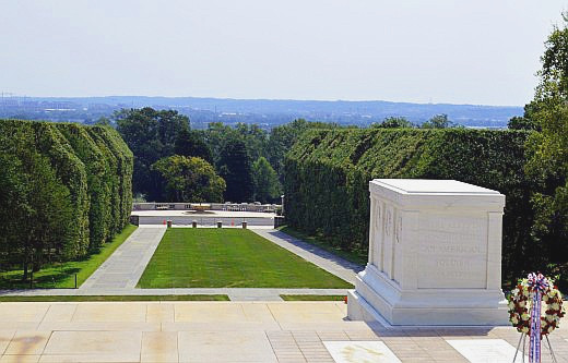 The Tomb of the Unknown Soldier overlooks the cemetery and Washington D.C. in the distance.