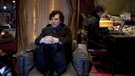 Sherlock waiting for a case while Watson writes on his blog.