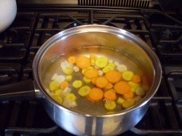 Put the carrot slices in boiling water for three minutes. This was the first batch, and all I had ready when the water boiled; you can put in more than this.