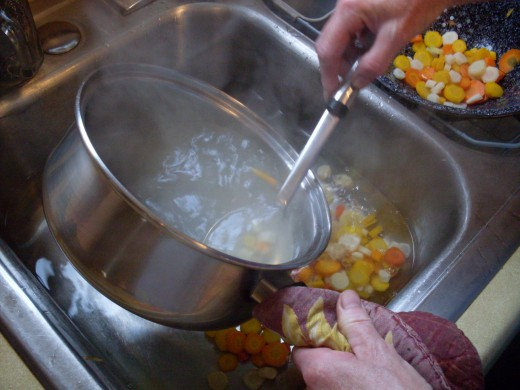 """Scoop the carrots into very cold water, to """"shock"""" them and stop the coooking."""