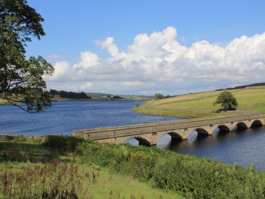 The smaller Roundhill Reservoir, linked by a watercourse to Leighton Reservoir to the north-east, and ultimately the River Ure by Swinton near the market town of Masham