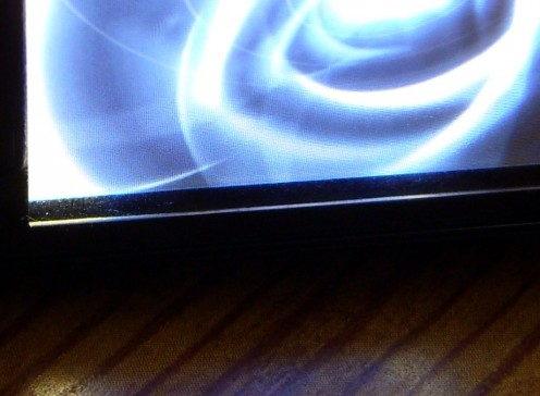 It's very difficult to see dirt on the invisibleSHIELD against the backlight, though it is visible at an angle.
