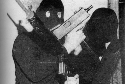 Armed Official IRA gunmen photographed in the 1970s with Armalite and Ingram Mach 10