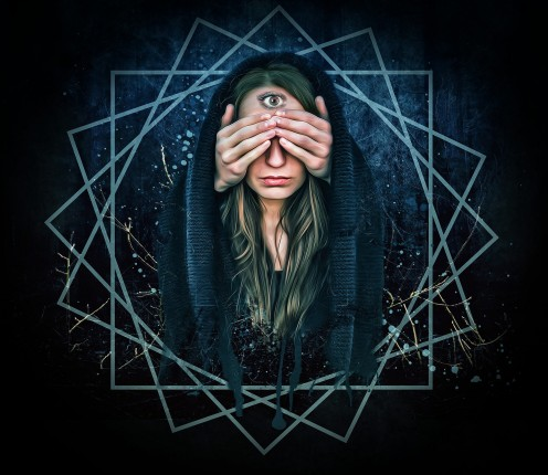 This photo symbolizes using a part of your body to open up your sense to what is out there in this world. This woman is using her third eye chakra.