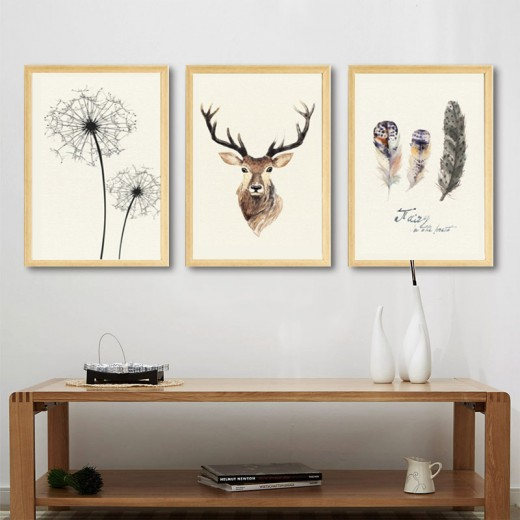 Wall art of Dandelion, Deer, and Feather.
