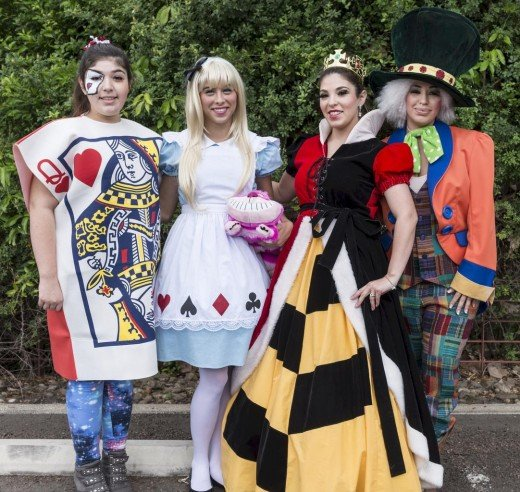 The card soldier, Alice in wonderland, the Queen of Hearts, and the Mad hatter,