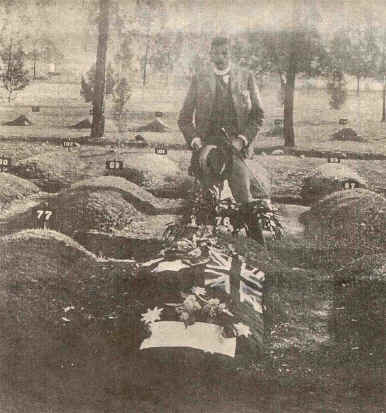 Major J.F. Thomas  standing over the grave of Harry Harbord 'Breaker' Morant and Peter Handcock, 1902.
