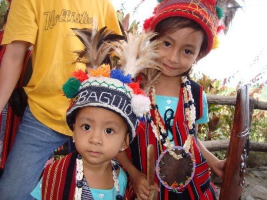 These two cute children here are daughters of my fellow engineer, bosom friend and classmate then, Melencio Santos. They are wearing a very ethnic yet dazzling Igorot Dress in Baguio.