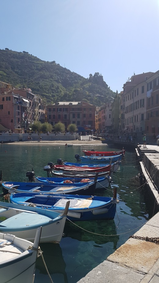 View of Vernazza from the harbor with colorful fishing boats