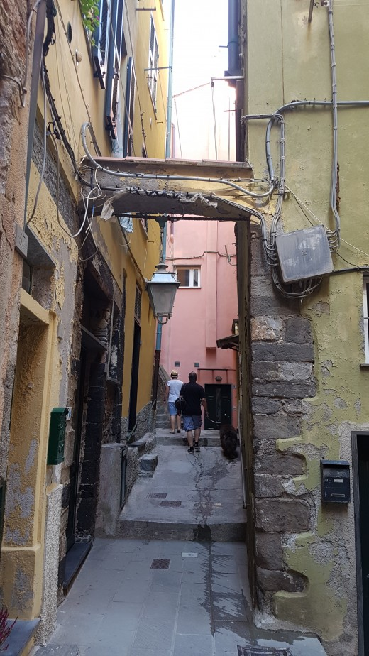 narrow street pasage between the Typical Ligurian Houses with arch buildings in Vernazza