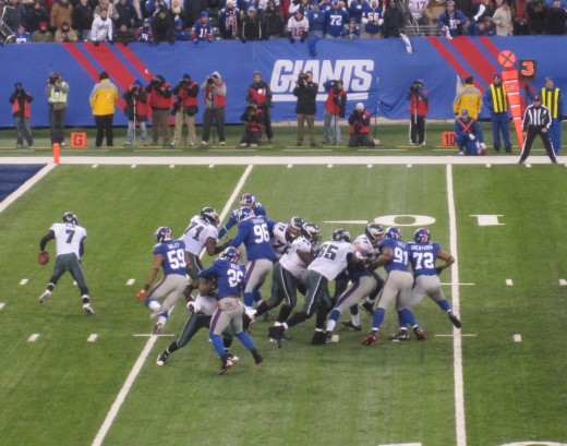 Michael Vick scrambles to avoid the Giants' pass rush, December 19, 2010