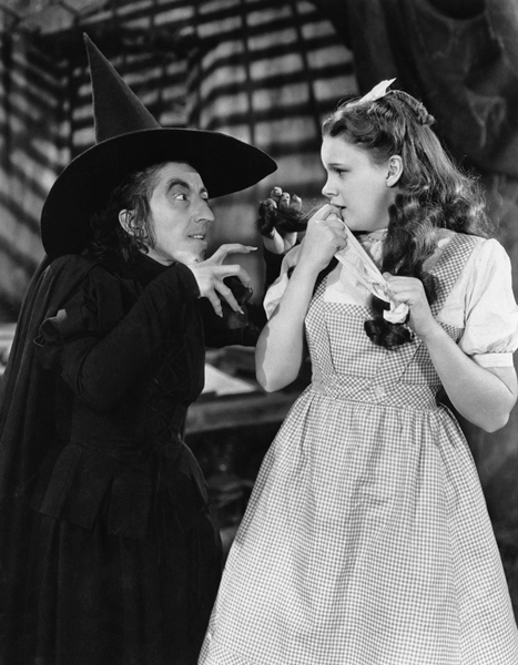 Wizard of Oz, 1939, Margaret Hamilton, left, Wicked Witch of The West and Dorothy, Judy Garland.