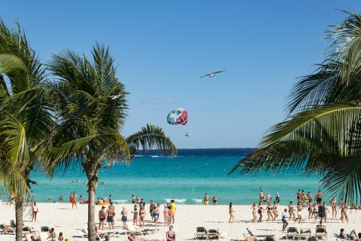 Parasailing on resort beaches is popular