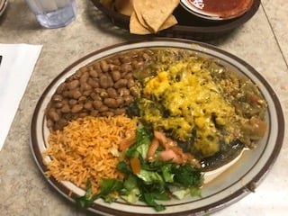 Blue corn enchilada plate (flat) at Monroe's on Lomas.