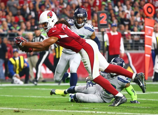 Arizona Cardinals wide receiver, Larry Fitzgerald, dives into the end zone for a touchdown against the Seattle Seahawks during a 2016 matchup. That season was one of the most heated in the intense rivalry between the Seahawks and Cardinals.
