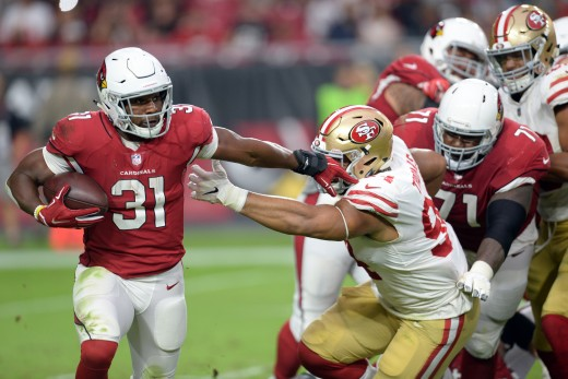Arizona Cardinals running back, David Johnson, stiff arms San Francisco 49ers defensive end, Solomon Thomas, during a 2018 matchup of the NFC West rivals.