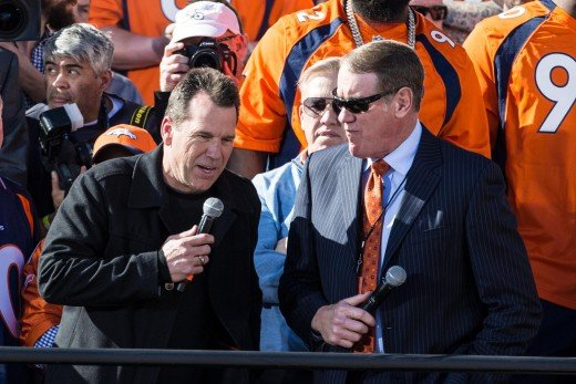 Former Cleveland Browns wide receiver, Dave Logan (right), interviews Denver Broncos head coach, Gary Kubiak, during the Super Bowl 50 championship parade celebration. Logan has worked as a radio broadcaster for the Broncos since retiring.