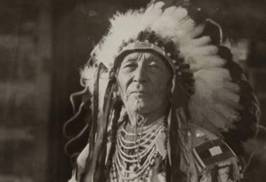Crow tribe elder wearing traditional headdress.