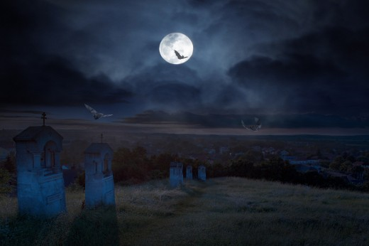A cemetery at night