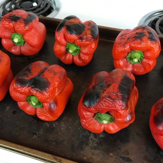 After the initial 13 minute cook time, give them a quarter turn and roast the remaining sides for 5 minutes each. The skin should be blackened and the peppers wilted. You want this to happen because it makes the skin papery and easy to peel off.