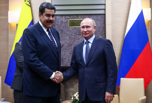 """Venezuela's President Nicolas Maduro (l) and Russia's President Vladimir Putin (r) shake hands during a meeting at the Novo-Ogaryovo residence on December 5, 2018."" Valery Sharifulin"